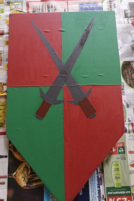 Schild mit gekreuzten Schwertern